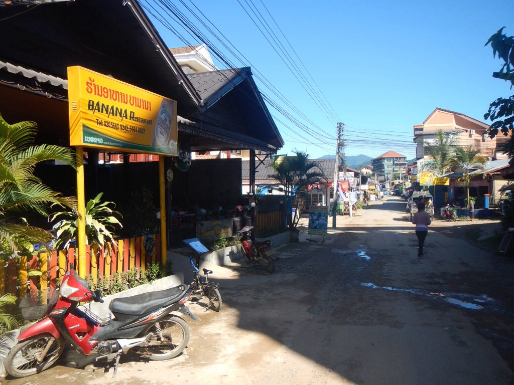 "A main street in Vang Vieng, lined with ""Friends bars"""