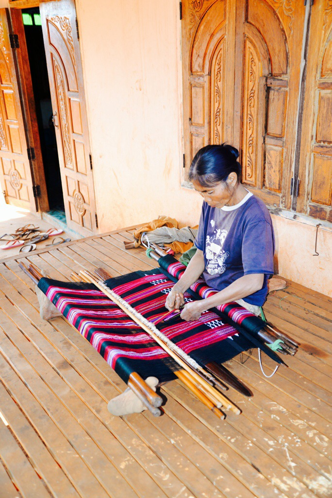 A Katu woman weaving