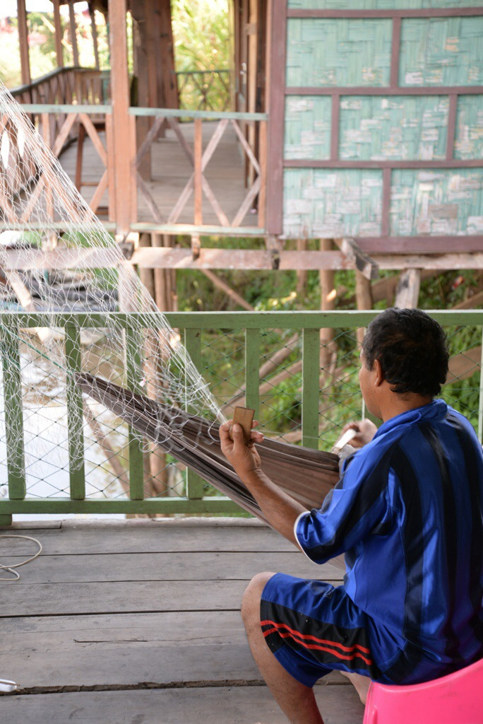 A local man, makes his fishing net. Here locals are quite self sufficient and not reliant on tourism.
