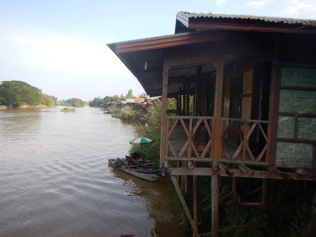 A typical bungalow restaurant hanging off into the Mekong